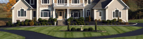 residential services: landscaped home with cut lawn